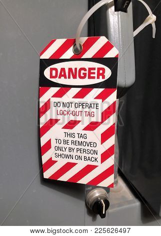 Lock Out Danger Tag Fastened To An Electrical Panel For Safety