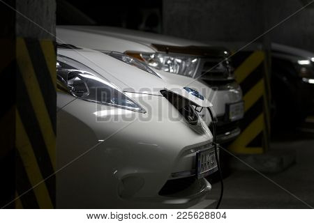 Kiev, Ukraine - October 10, 2017: Nissan Leaf Electric Car Charging At Underground Parking.  Fuel Ga