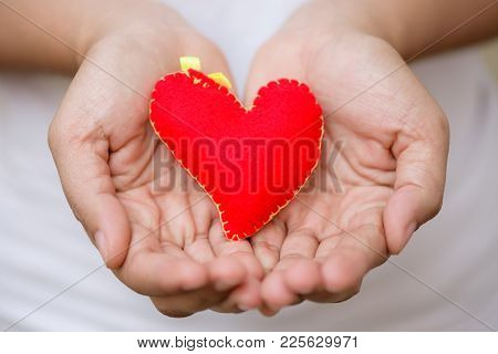 Woman Giving Red Heart And Love In Valentine's Day. People, Charity, Family And Love Concept.