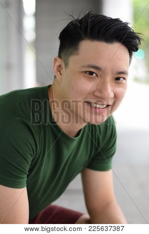 A Young Handsome Asian Chinese Man Smiling At Camera