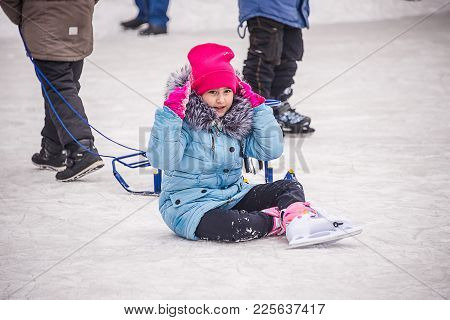 In Winter, The Child Fell On The Ice, Sitting On The Rink Winter Joy