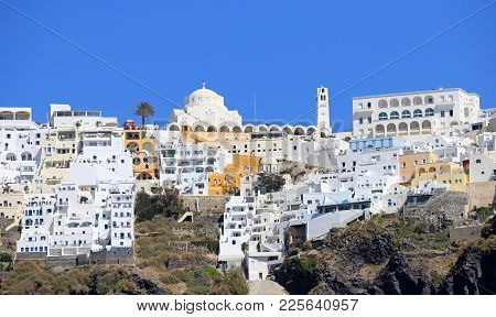 Fira Town, Capital Of The Santorini Island Cyclades In Greece.  Perched High On Top Of The Island.