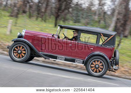 Adelaide, Australia - September 25, 2016: Vintage 1928 Oldsmobile F28 Tourer Driving On Country Road