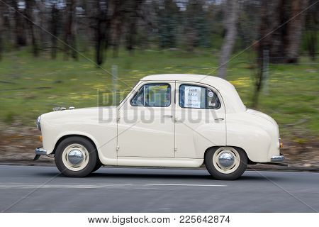 Adelaide, Australia - September 25, 2016: Vintage 1953 Austin A30 Sedan Driving On Country Roads Nea