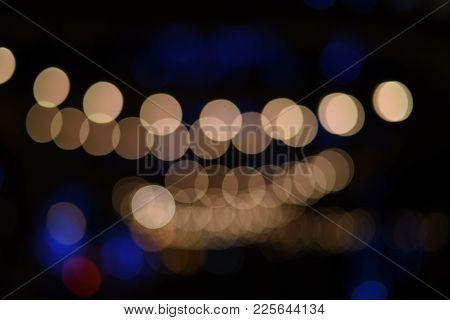 Bokeh Lens Effect Lights Blurred Of White Strands Of Lights Draped Overhead At Night