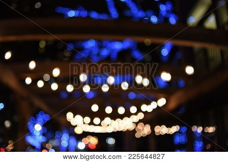 Bokeh Lens Effect Lights Blurred Of White Strands Of Lights Draped Overhead At Night For Terrace Out