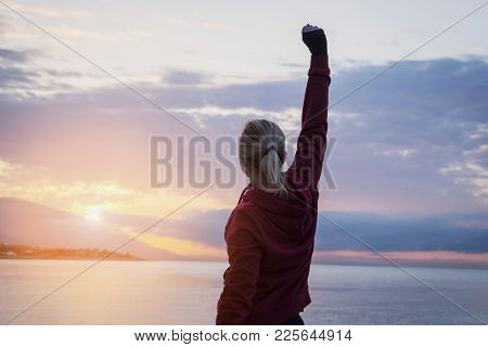A Woman's Freedom With His Hand Raised At The Seaside.