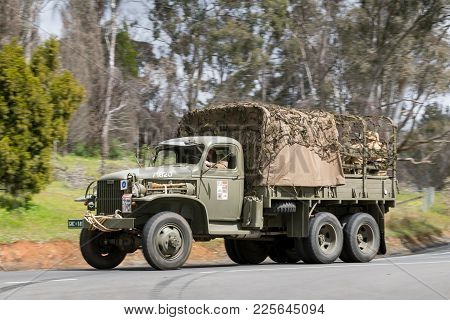 Adelaide, Australia - September 25, 2016: Vintage 1941 Gmc Cckw-353 Troop Carrier Driving On Country