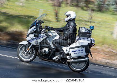 Adelaide, Australia - September 25, 2016: South Australian Police Officer Riding A Bwm Police Motorc