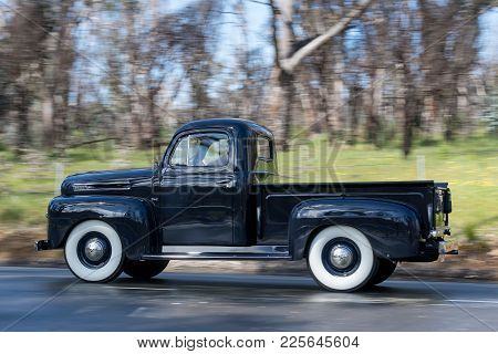 Adelaide, Australia - September 25, 2016: Vintage 1949 Ford F1 Utility Driving On Country Roads Near