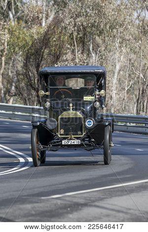 Adelaide, Australia - September 25, 2016: Vintage 1915 Ford T Tourer Driving On Country Roads Near T