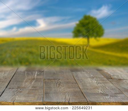 Spring Field Blurred Background Of Rural Landscape  And Desk