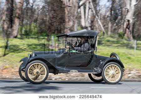 Adelaide, Australia - September 25, 2016: Vintage 1916 Dodge Roadster driving on country roads near the town of Birdwood, South Australia.