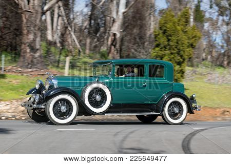 Adelaide, Australia - September 25, 2016: Vintage 1929 Lincoln L driving on country roads near the town of Birdwood, South Australia.