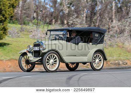 Adelaide, Australia - September 25, 2016: Vintage Car driving on country roads near the town of Birdwood, South Australia.