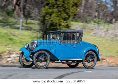 Adelaide, Australia - September 25, 2016: Vintage 1932 Austin 7 Chummy Roadster driving on country roads near the town of Birdwood, South Australia.