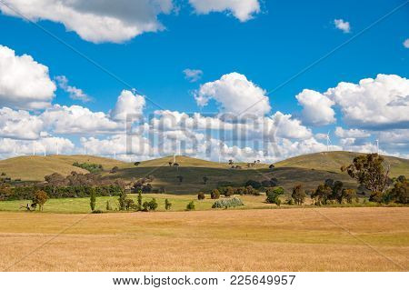Picturesque Countryside Landscape With Wind Electricity Turbines. Clean Energy, Green Electricity Ba