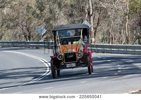 Adelaide, Australia - September 25, 2016: Vintage 1911 Ford T Tourer  driving on country roads near the town of Birdwood, South Australia.