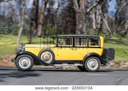 Adelaide, Australia - September 25, 2016: Vintage 1929 Graham Paige 827 Sedan driving on country roads near the town of Birdwood, South Australia.