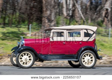 Adelaide, Australia - September 25, 2016: Vintage 1928 Ford Model A Tourer driving on country roads near the town of Birdwood, South Australia.