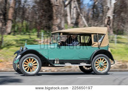 Adelaide, Australia - September 25, 2016: Vintage 1915 Hupmobile N Tourer driving on country roads near the town of Birdwood, South Australia.