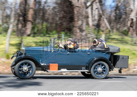 Adelaide, Australia - September 25, 2016: Vintage 1927 Morris Empire Oxford Tourer driving on country roads near the town of Birdwood, South Australia.
