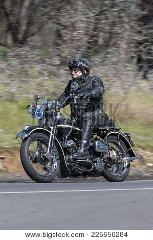 Adelaide, Australia - September 25, 2016: Vintage 1942 Harley Davidson WLA Motorcycle on country roads near the town of Birdwood, South Australia.
