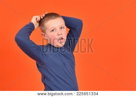 Cheerful Cheerful Boy. Good Mood. Boy On An Orange Background.