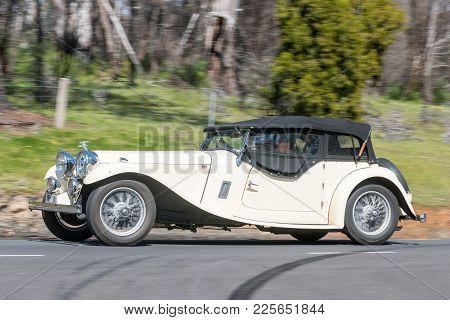 Adelaide, Australia - September 25, 2016: Vintage 1948 Jaguar Mk Iv Saloon Driving On Country Roads