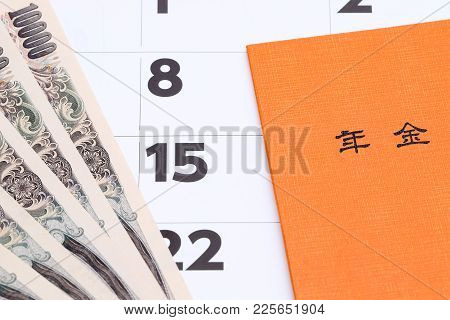 Kagawa, Japan - January 22: Japanese National Pension Plan Handbook And Money On Calendar Background