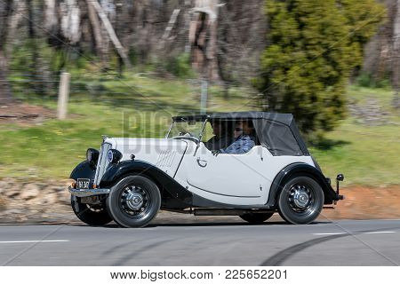Adelaide, Australia - September 25, 2016: Vintage 1938 Morris 8/40 Roadster  Driving On Country Road