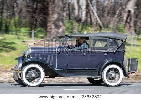 Adelaide, Australia - September 25, 2016: Vintage 1930 Ford Model A Phaeton Driving On Country Roads