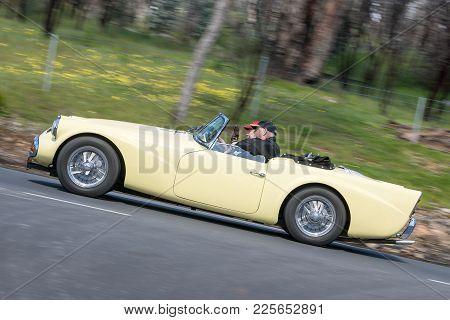 Adelaide, Australia - September 25, 2016: Vintage 1959 Daimler Sp 250 Roadster Driving On Country Ro