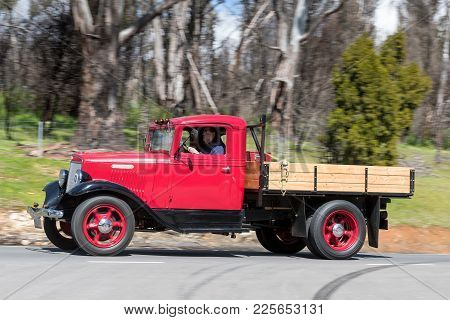 Adelaide, Australia - September 25, 2016: Vintage 1936 International Harvester C-30 Truck Driving On