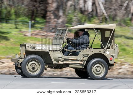 Adelaide, Australia - September 25, 2016: Vintage 1943 Ford Jeep Utility Driving On Country Roads Ne