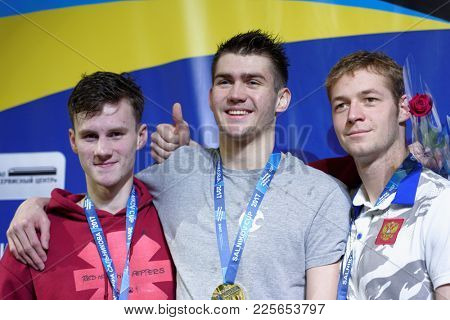 ST. PETERSBURG, RUSSIA - DECEMBER 22, 2017: Winners of XI Salnikov Cup in 100 m backstroke swimming Kliment Kolesnikov (center), Grigory Tarasevich (left) and Nikita Ulyanov, all from Russia
