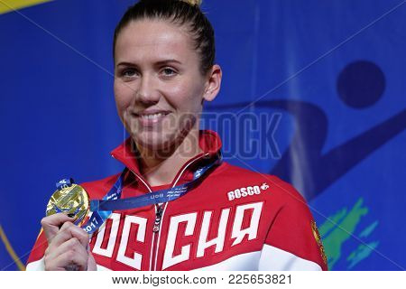 ST. PETERSBURG, RUSSIA - DECEMBER 22, 2017: Swimmer Anastasia Fesikova during award ceremony of Salnikov Cup. Fesikova takes gold medal in women 50m backstroke swimming