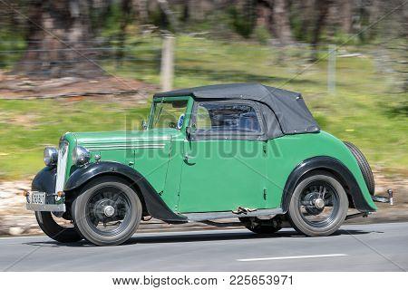 Adelaide, Australia - September 25, 2016: Vintage 1937 Austin 7 Roadster Driving On Country Roads Ne