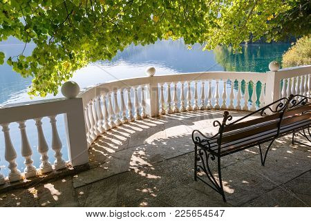 Openwork Metal Bench On A Semi-circular Balcony On The Shore Of The Picturesque Lake Ritsa, Abkhazia