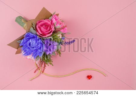 A Bouquet Of Colorful Paper Flowers And A Small Red Heart On A Pink Background As A Backdrop For A P
