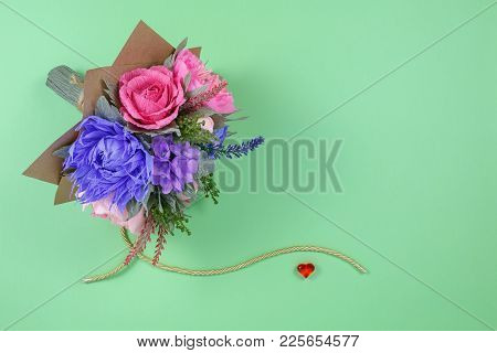 A Bouquet Of Colorful Paper Flowers And A Small Red Heart On A Green Background As A Backdrop For A
