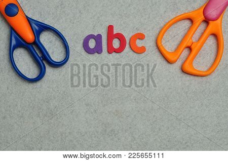 Abc On A White Background With Two Scissors