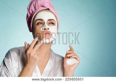 Woman With Towel On Her Head After Shower Apply Cleansing Mask On Face