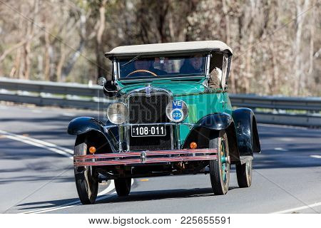 Adelaide, Australia - September 25, 2016: Vintage 1929 Chevrolet Ac Roadster Driving On Country Road