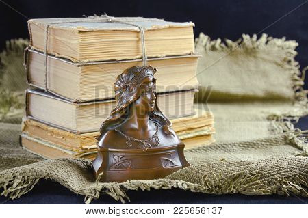 Old Books And A Bronze Bust On The Table. Still Life, Object, Exterior