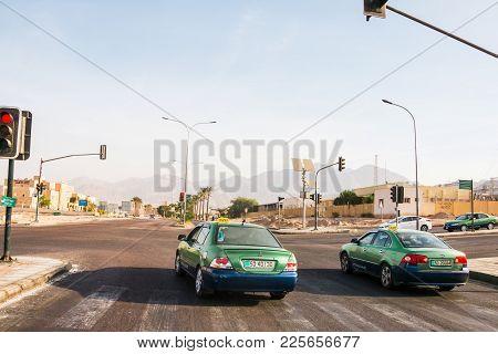 Aqaba, Jordan - December, 22, 2017: Cars On The Road On A Sunny Day In Aqaba In Jordan