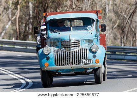 Adelaide, Australia - September 25, 2016: Vintage 1946 Chevrolet 1421 Truck Driving On Country Roads