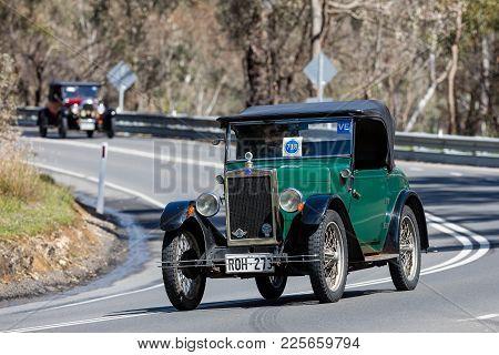Adelaide, Australia - September 25, 2016: Vintage 1929 Morris Cammy Minor Roadster Driving On Countr