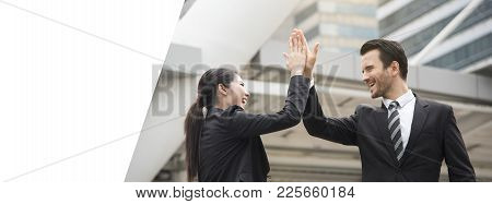 Businessman And Businesswoman Hands High Five Meeting Greeting. Panoramic Banner With Copy Space.