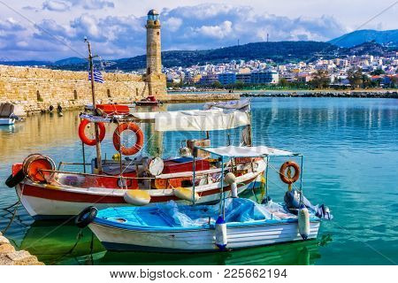 Pictorial Rethymnon town with old lighthouse and fishing boats, Crete island, Greece